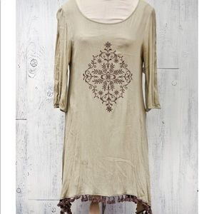 Sage green dress with embroidery and tassel trim